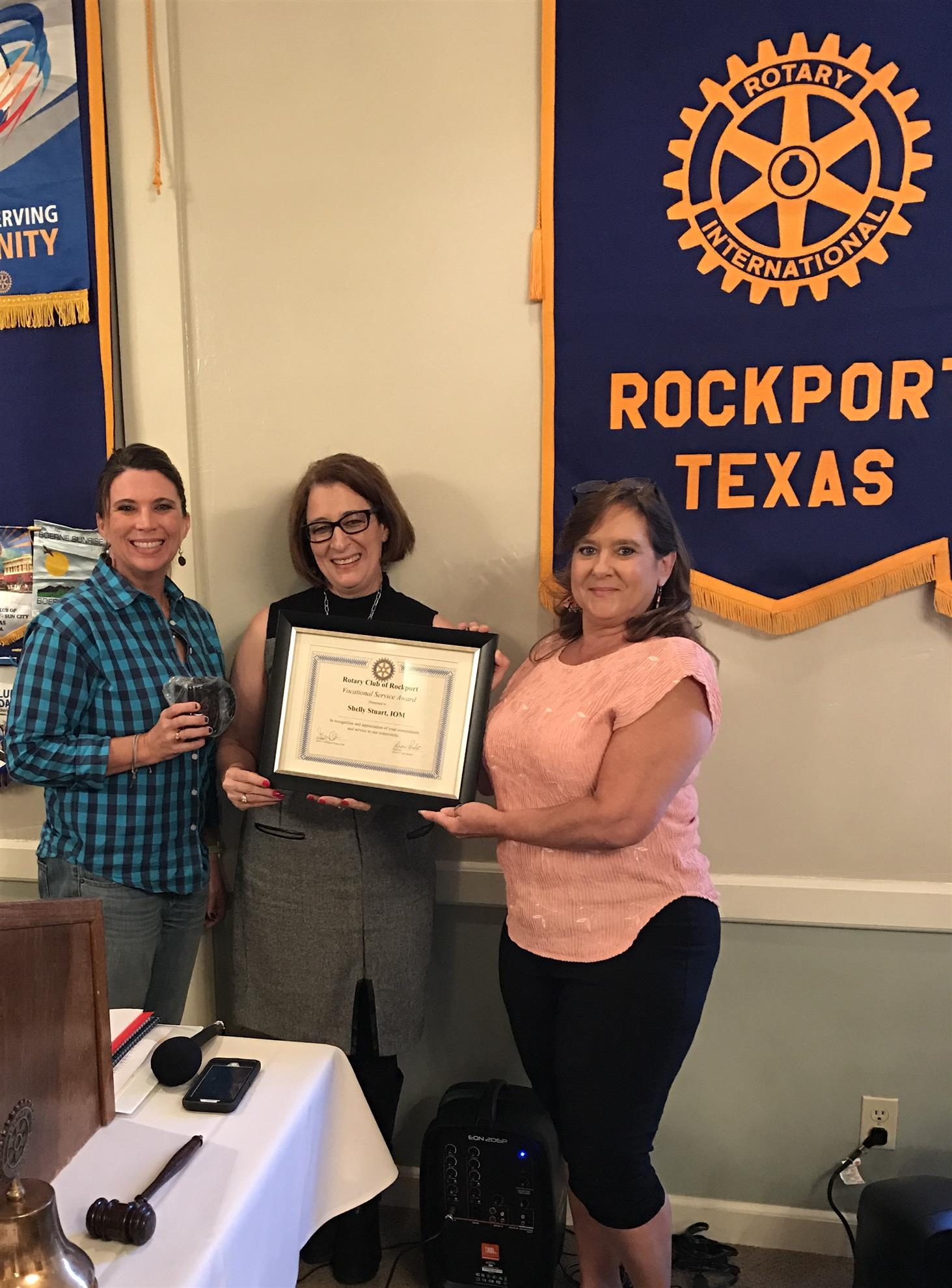 Rotarian Diane Probst congratulated Shelly Stuart from the Rockport-Fulton  Chamber of Commerce on doing a good job by awarding her our Vocational  Award for ...