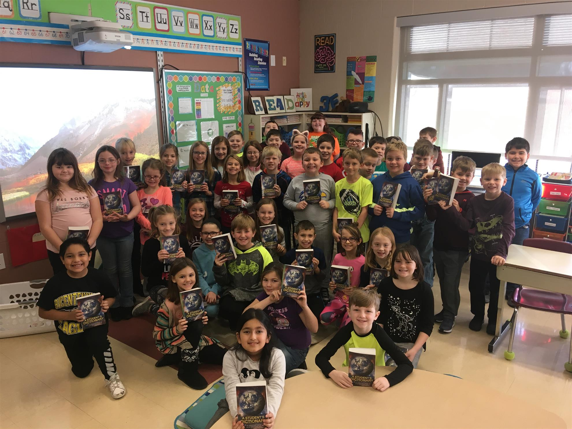 dictionaries to third graders