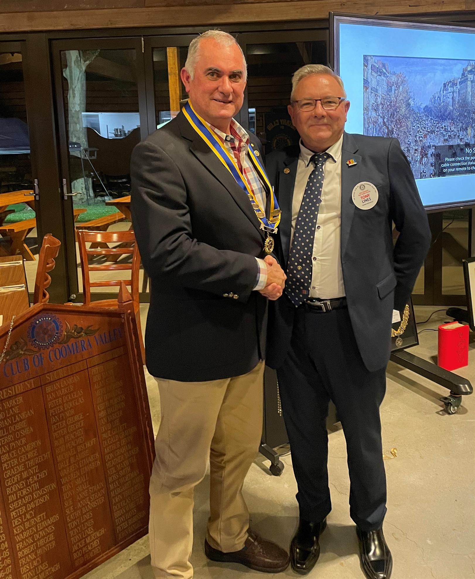 Tony Lines passing the presidency to Des Lacy
