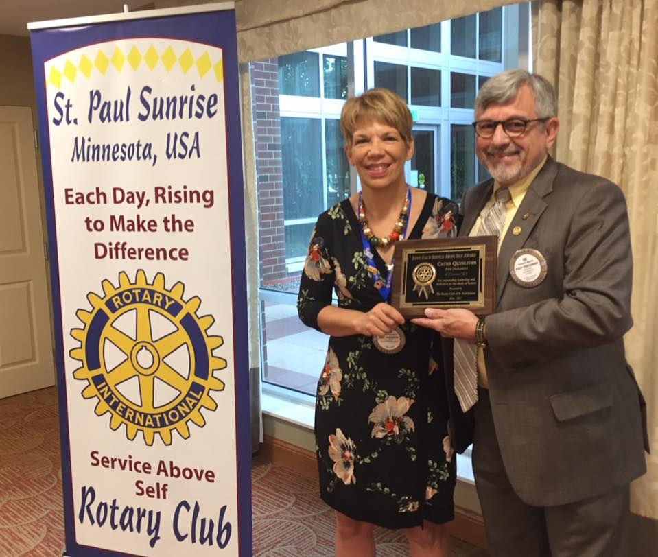 Cathy Quinlivan accepts the Jerry Fleck Service Above Self Award from Club President Ed Marek.