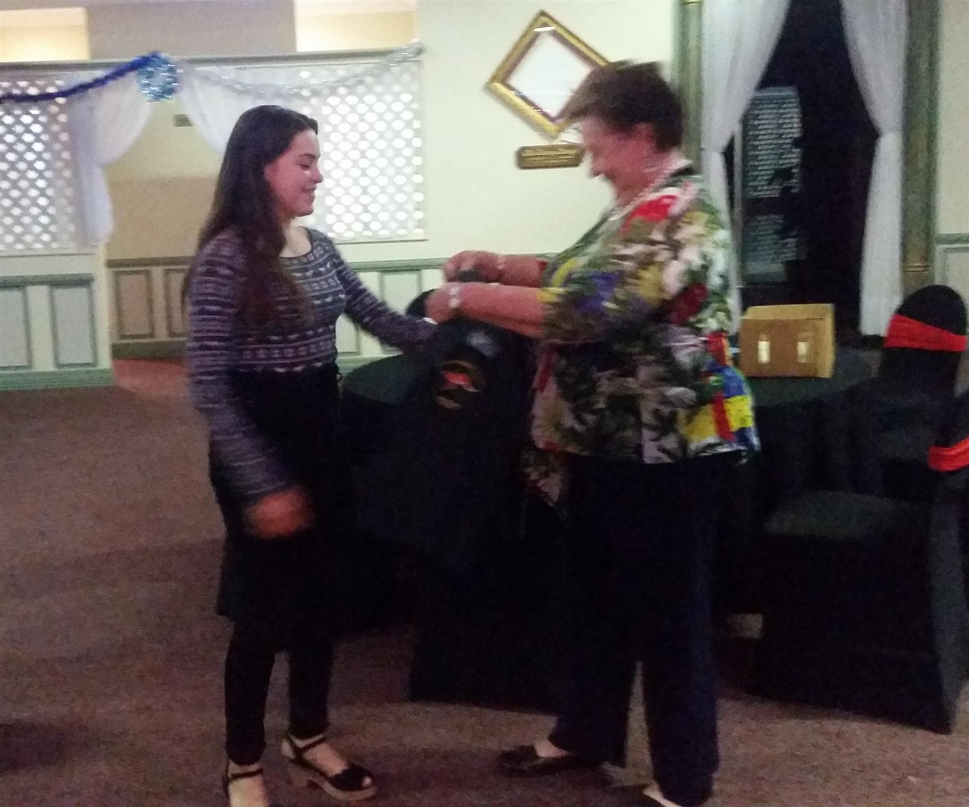 President Fran presents Anna Henderson with her new Rotary Blazer