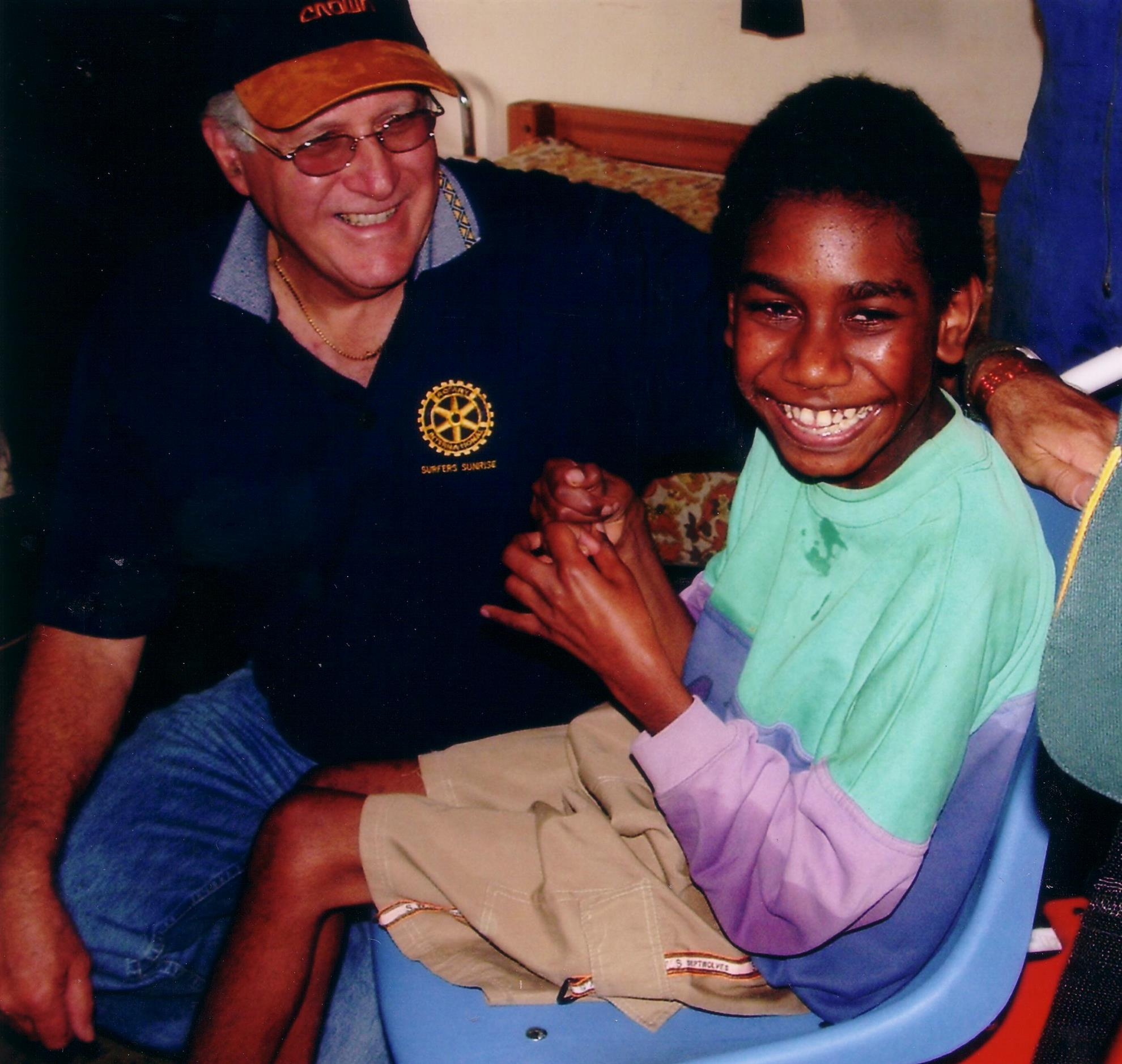 Des La Rance presents the first wheelchair to a disabled child, Fiji August 1997