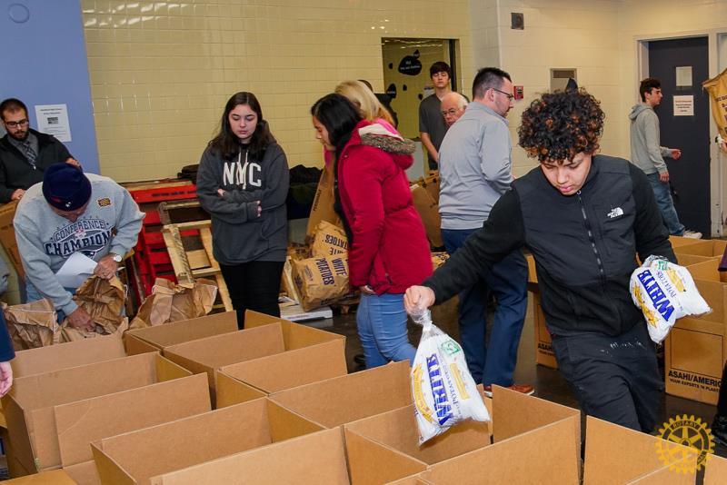 Medford Voc Tech students helping fill food baskets.