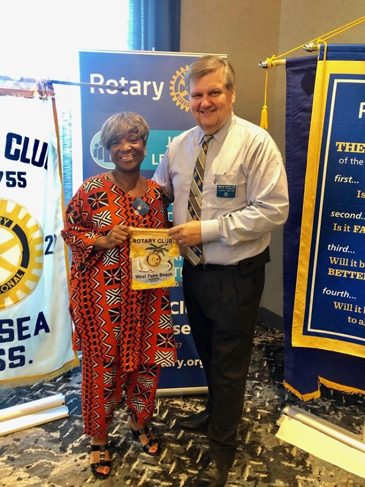 PP Rev. Sandra Whitley brought back a beautiful Rotary Club of West Palm Beach banner!