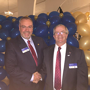Jim Major congratulates new Woburn Rotary President Bill Sullivan at District 7930 Installation event.