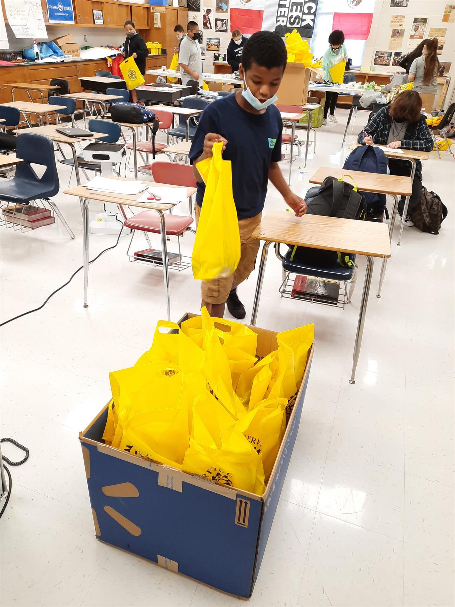 Students from FD Moon Middle School prepare hygiene kits for our club