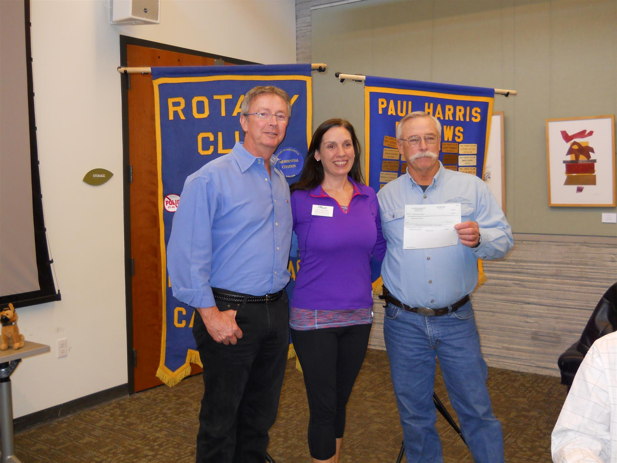 fallbrook land conservancy presented donation  erica williams presented a check for 2265 to fallbrook land conservancy representatives william shakespeare and mike peters the money was raised during