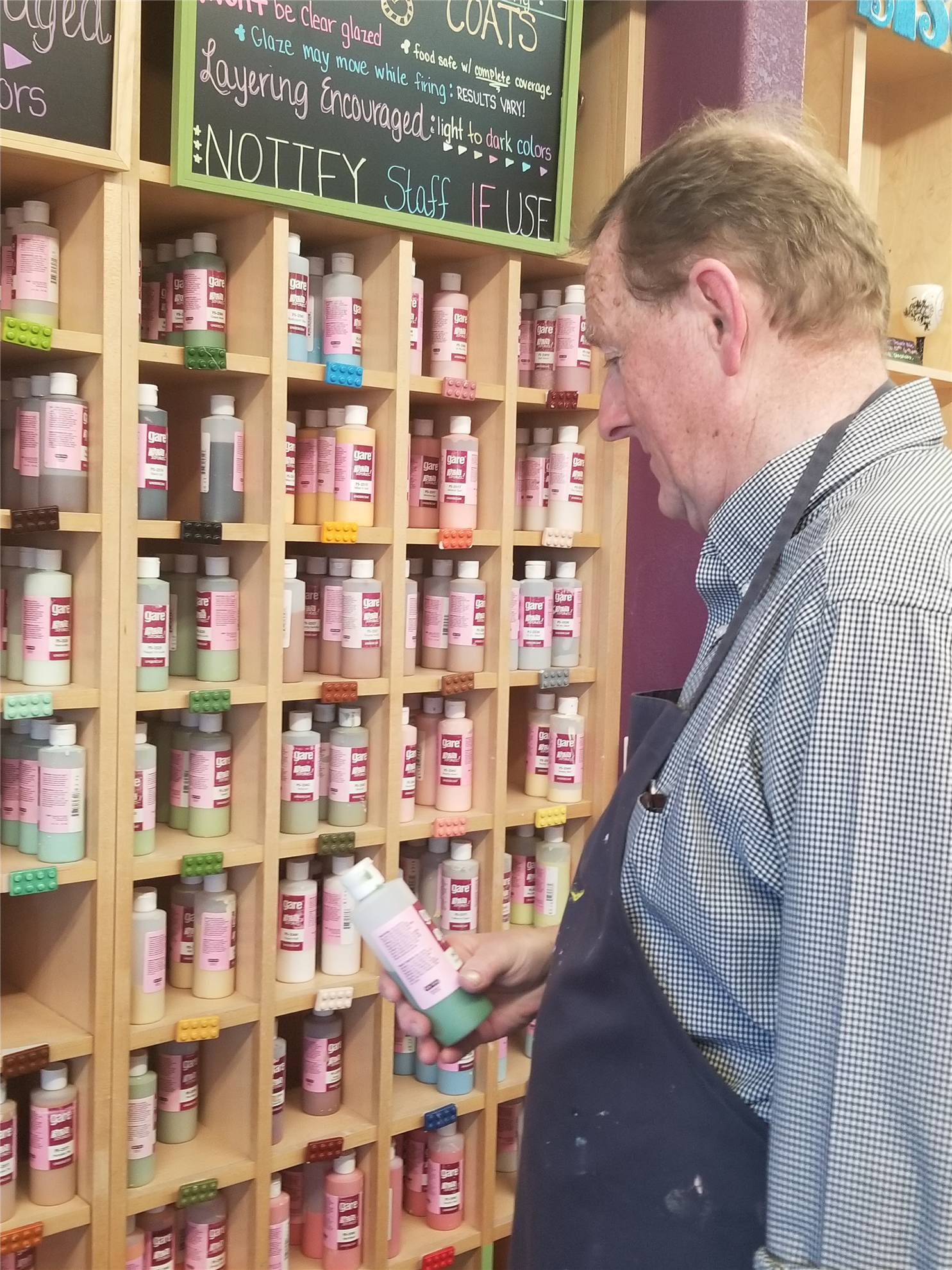 Darrell choosing paint for his Empty Bowl