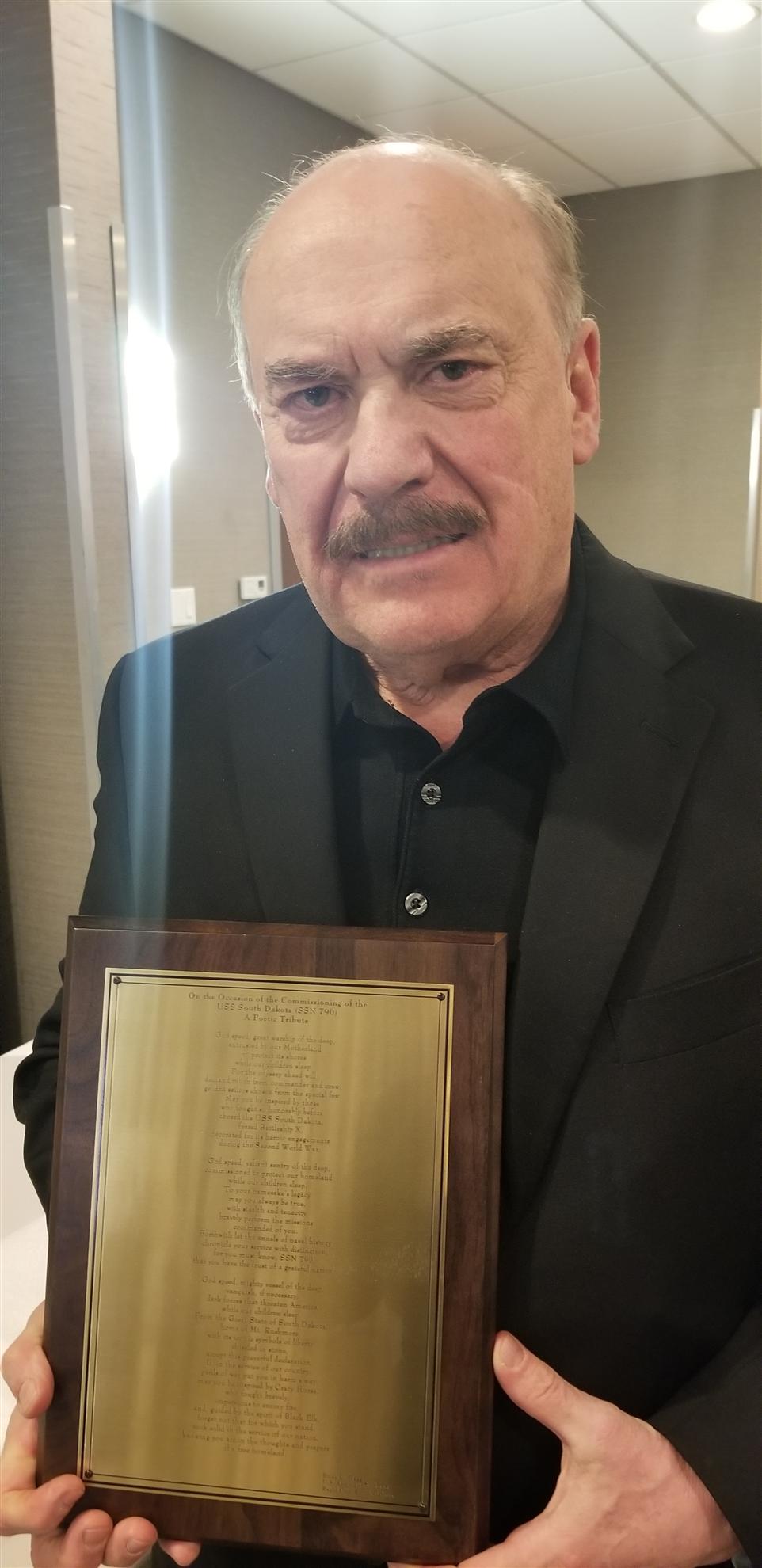 Brian Hagg with Commemorative USS South Dakota poem.