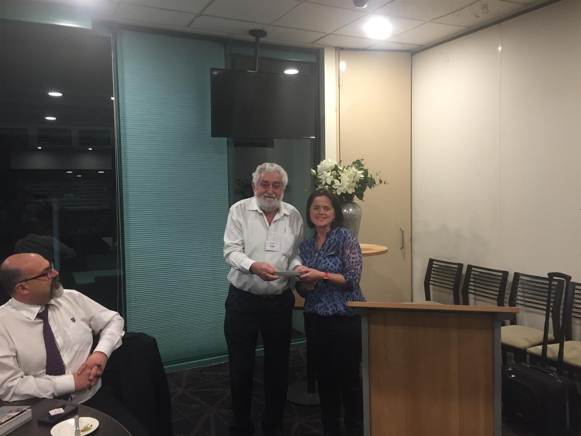 Brian Hanson Presenting our Speaker Penny after her talk on kidney health with