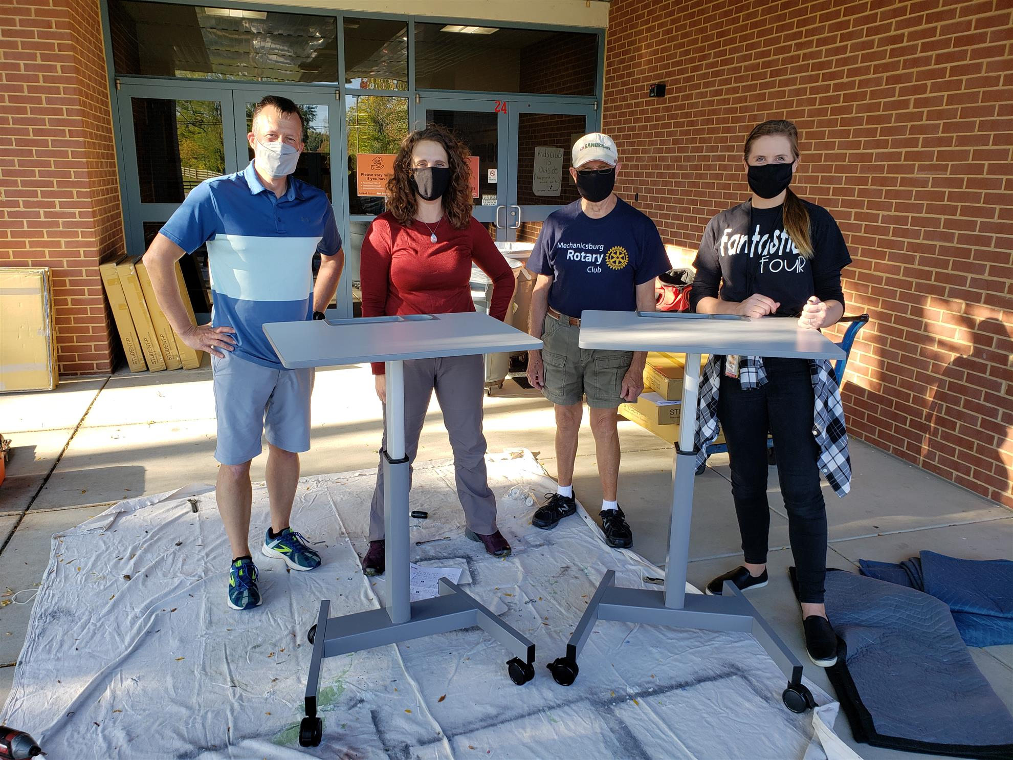 Mr. Eric Davis (CVSD teacher), Rotarian Amy Bockis, Rotarian Dave Burns, & Ms. Taylor Campbell (Monroe Elementary 4th Grade Teacher): Desk Assembly Team