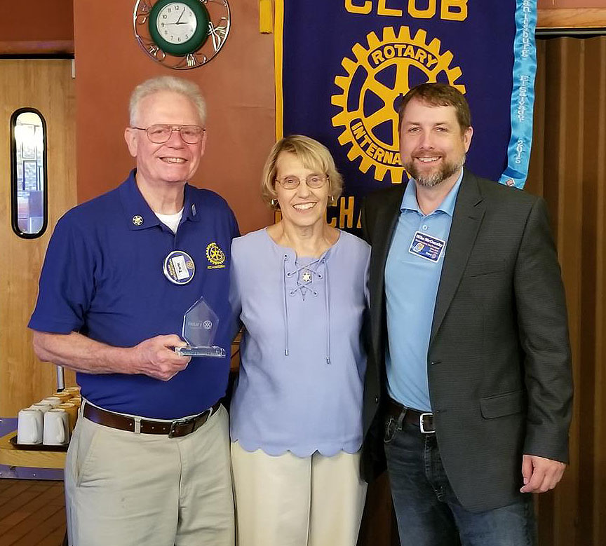 From Left to Right, Treasurer Tom Burson, Kathy Burson, and Current President Mike McConahy