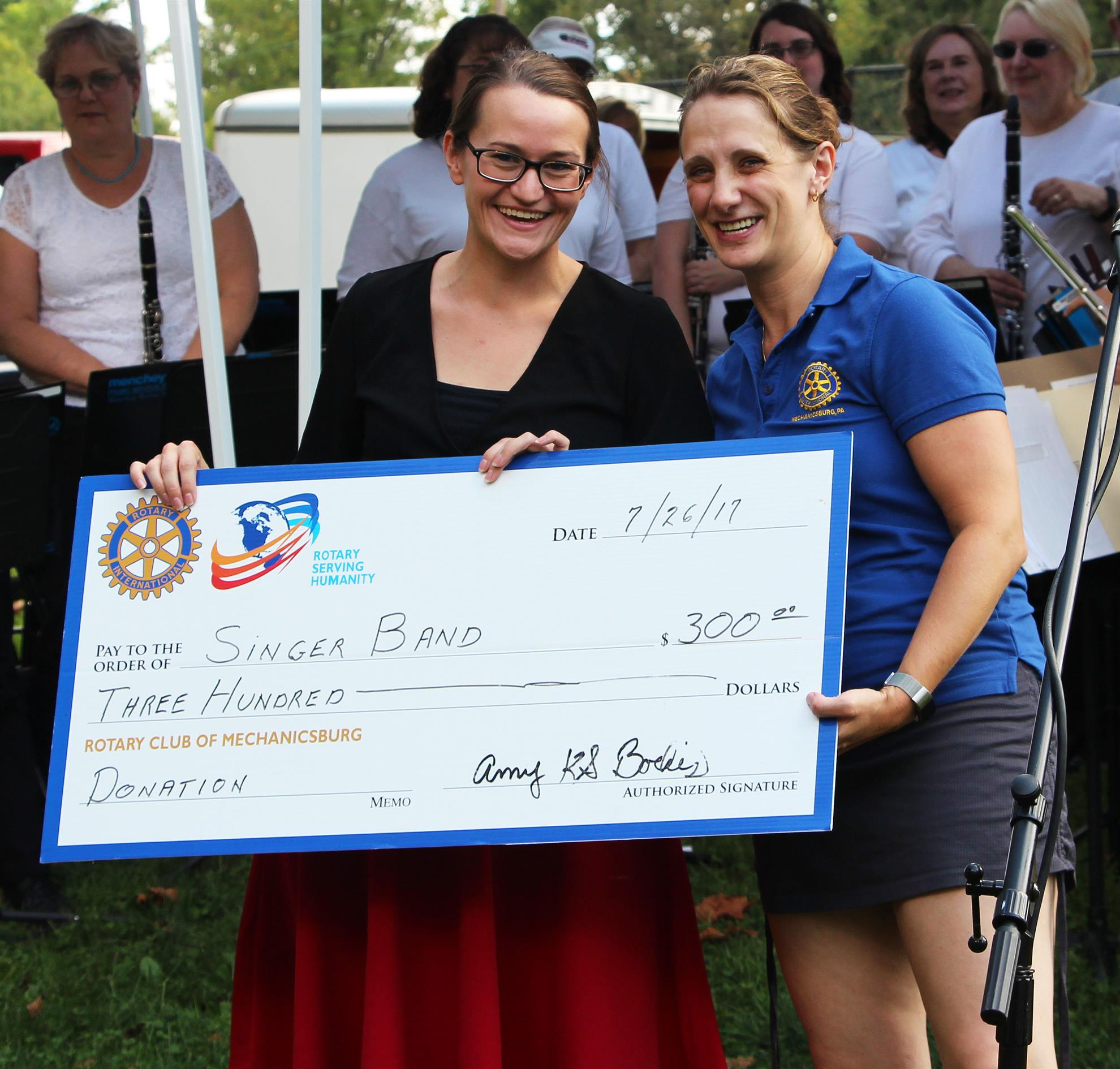 Singer Band Receives Donation At Ox Roast