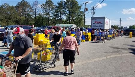 COVID-19 Cannot Stop Rotarians From Feeding 500+ Families; 05-15-20