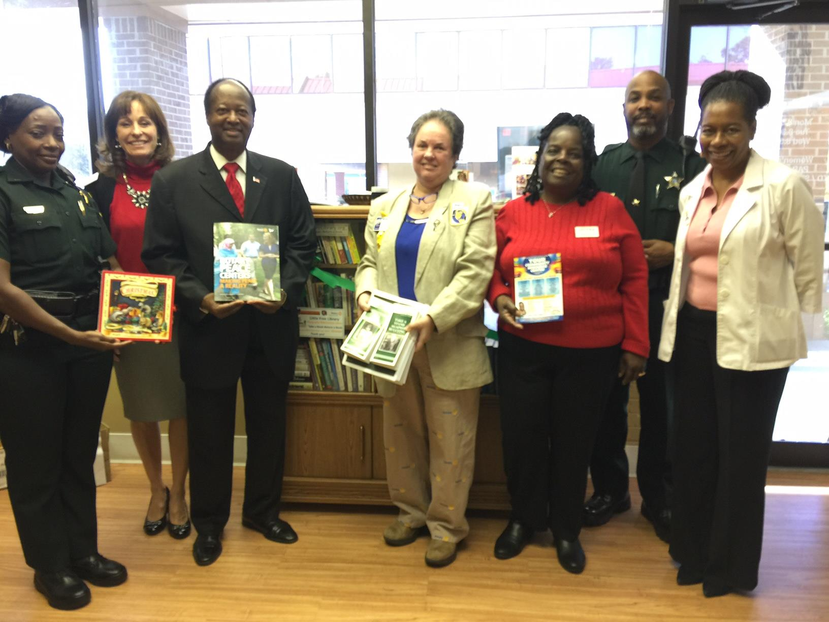 Lt Frost, Congressman Webster's rep Cindy Brown, Orl Comm Ings, DrO, Ansar of Charity & Love, ACorp Stanley Murray add to the Little Free Library.