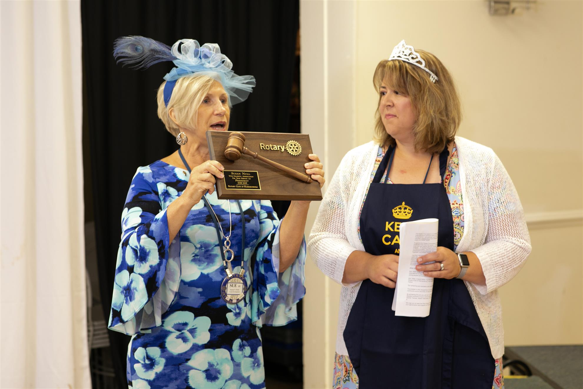 An apron, gavel, and tiara as gifts for a club well run