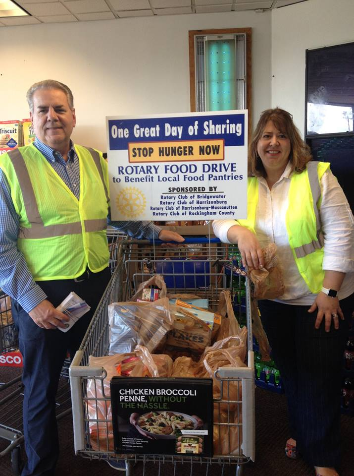 One Great Day of Sharing: Rotarian Donn & club president Susan with lots of food donations