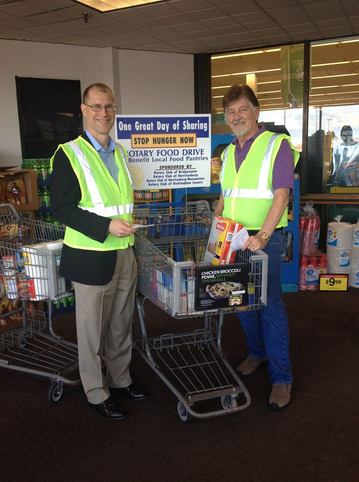 One Great Day of Sharing: Rotarians Robert and Howard collecting food donations