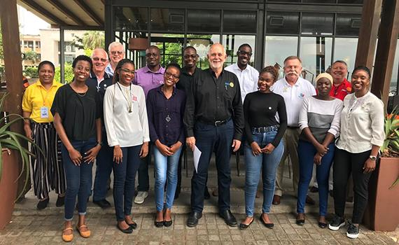 RI President Barry Rassin, middle, with Rotaractors in Mozambique.
