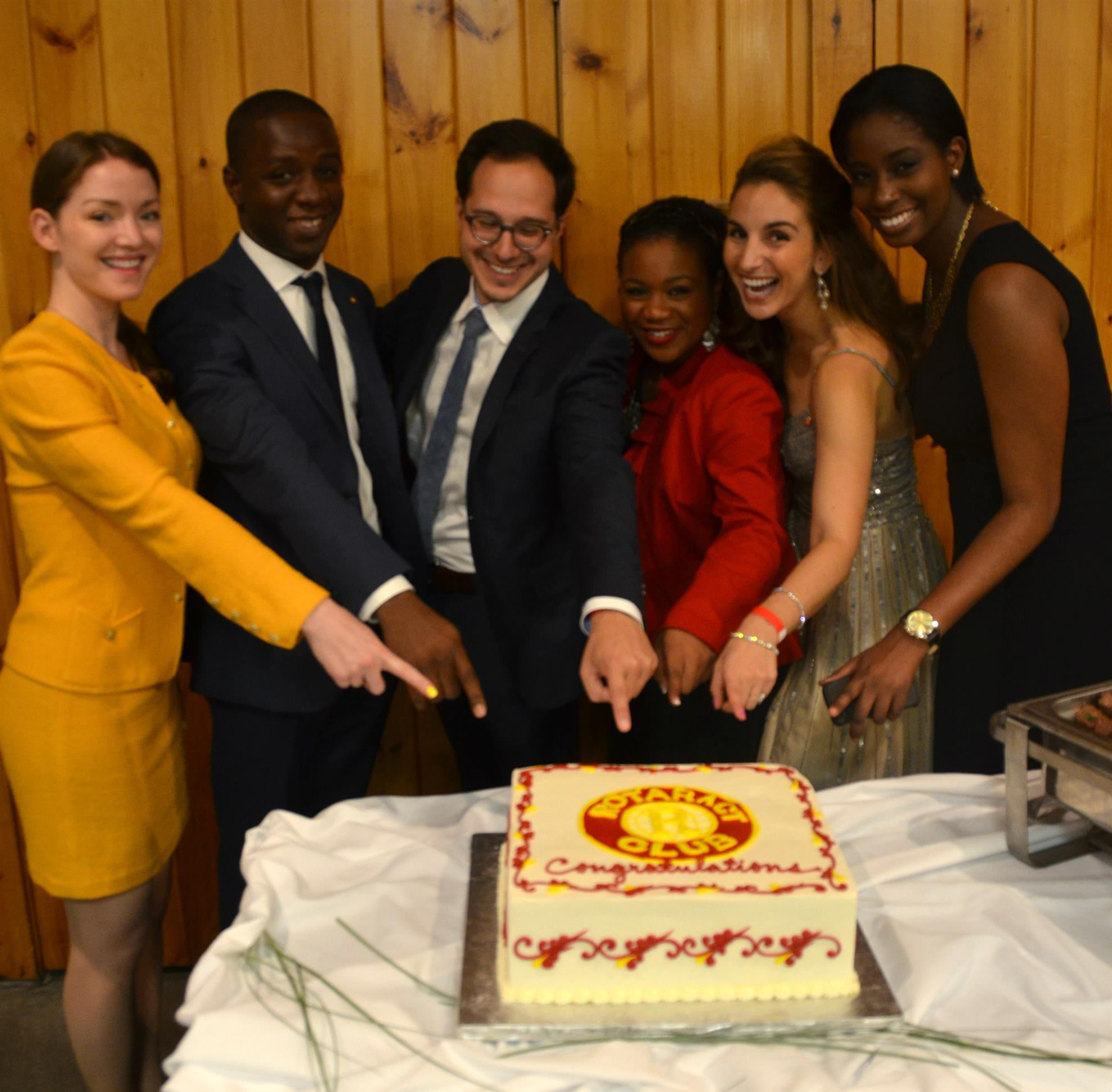 Past board members posing with our anniversary cake.