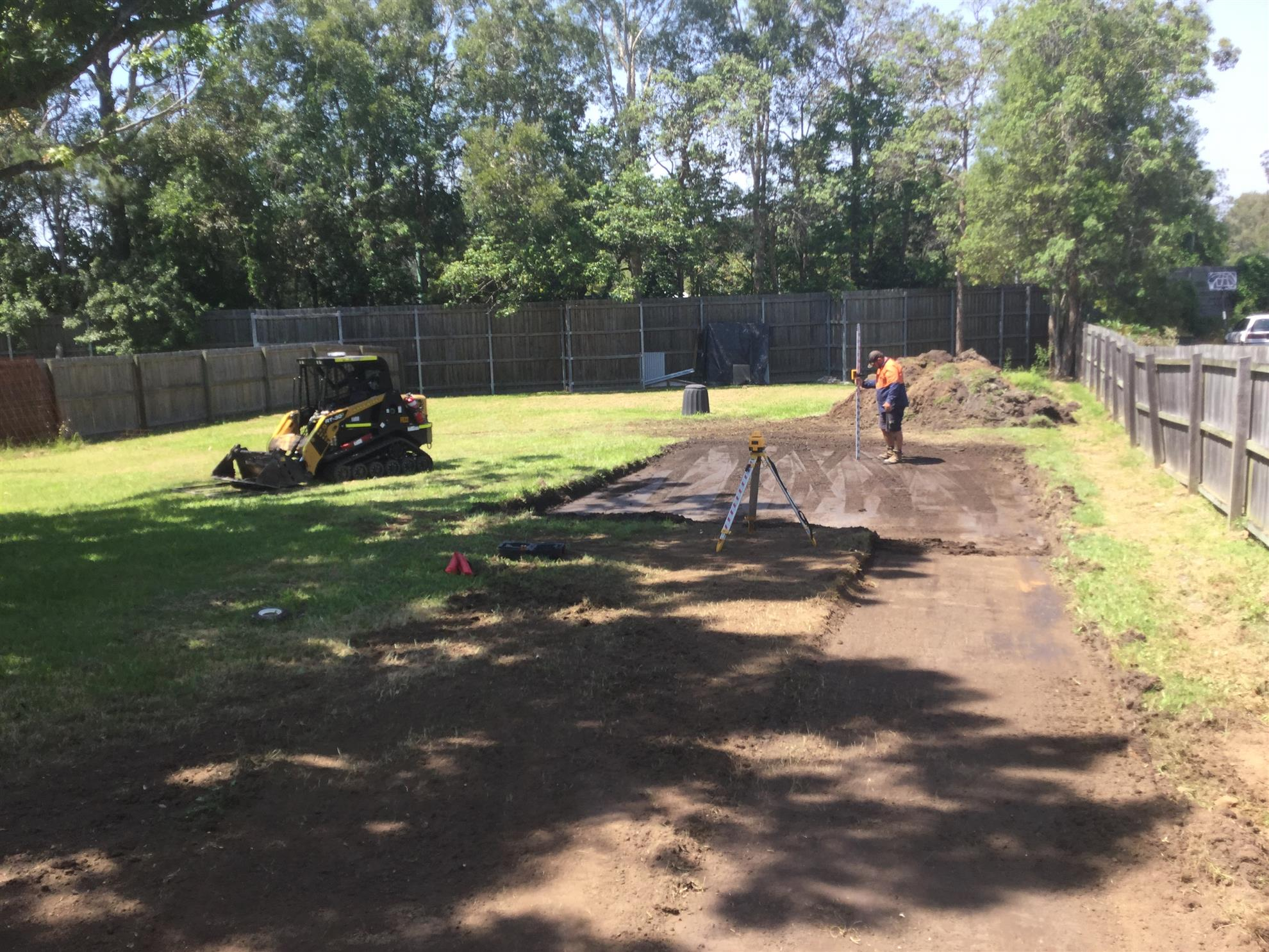 Clearing the path and ball court area...