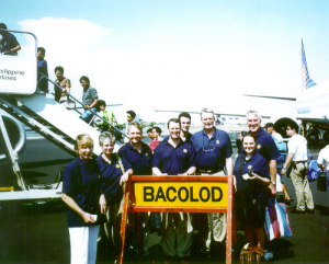 First Canterbury Eye Screening Team arriving at Bacolod, Philippines, May 1997: (L-R) Jenny Simpson, Marley Corinaldi, Bruce Gallagher, Richard Goss, Adrian Goss, Tony Simpson, Robyn Hawley, Rod Corinaldi.