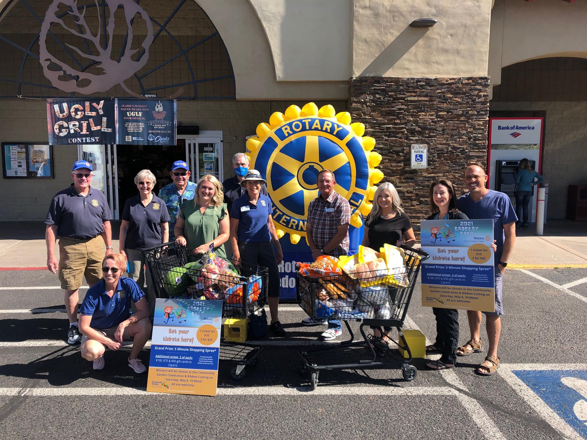 Representatives from Shelter with their carts and Rotary Club members