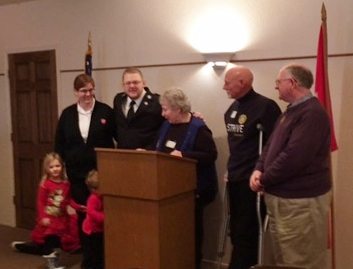 (L-R) Greg's wife, Elizabeth and their two children,Greg Bock, Kay Bohls,Marshall Beck and Assistant Gov. Dave Thomas
