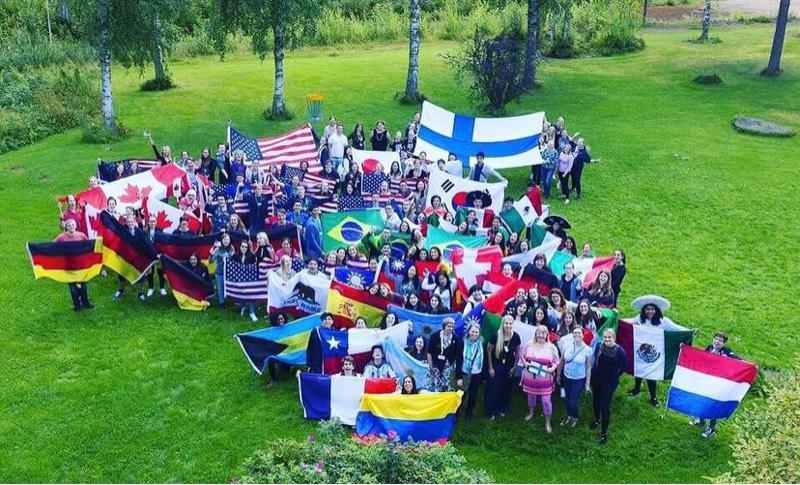 Photo of exchange students with flags