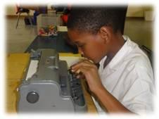 South African boy using a braille writer