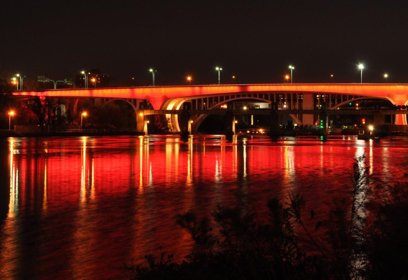 I-35W Bridge lit in End Polio Now colors