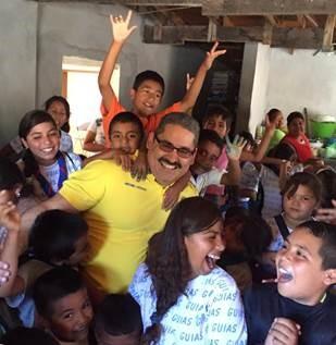 Antonio Cachazo with kids at a community center in Ciudad Juarez.