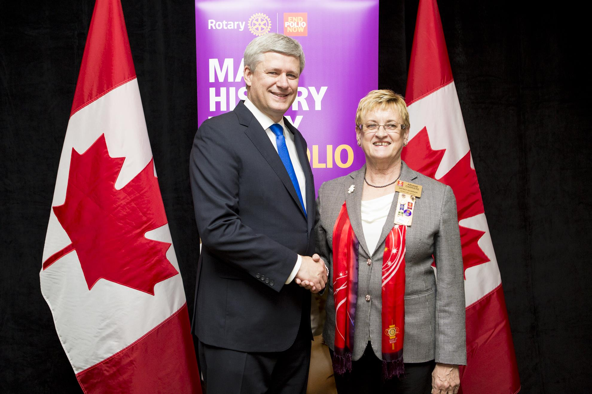 PM Stephen Harper and District Governor Arriane Carriere