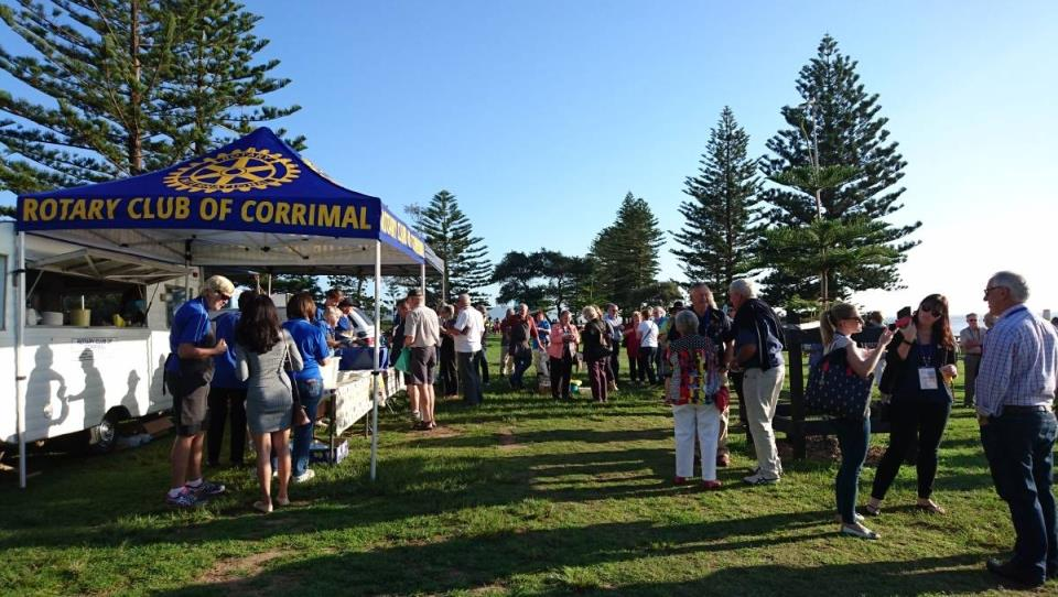 Rotarians gathered on the foreshore