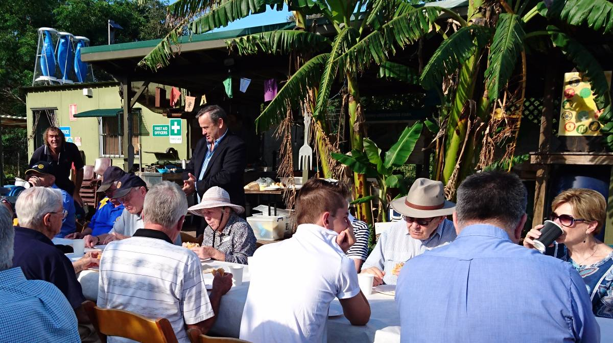 Breakfast in the park: Rotary Club of Wollongong past president Geoff Goeldner explains the significance of Greenhouse Park at the club breakfast meeting.