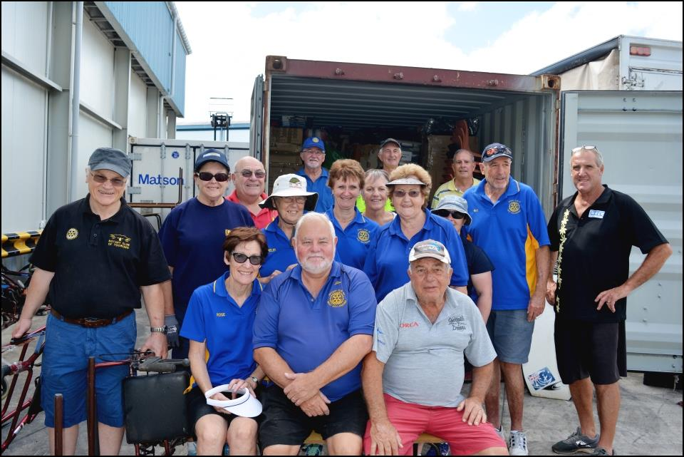 Members of the Rotary Club of Wollongong, Australia pause for a photo while unloading the container.