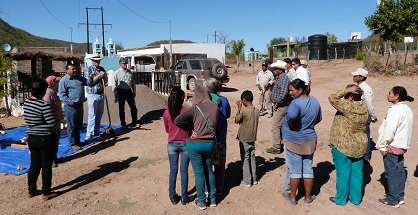 Las Minitas villagers gather to learn about the water filters (RCS Rotarian Jim Hann 5th from left)