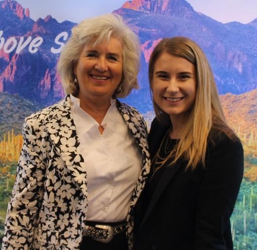 •Rotarian Sara Crosby-Hartman introduces Global Grant winner, Carlyn Harris to club members.