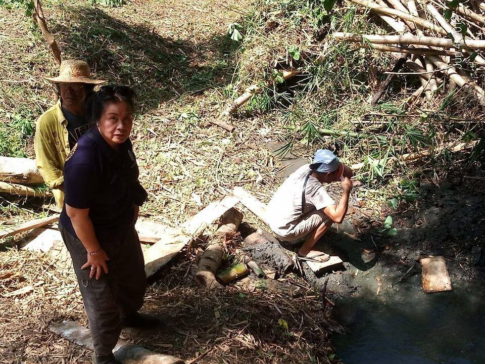 Residents drinking from a murky water