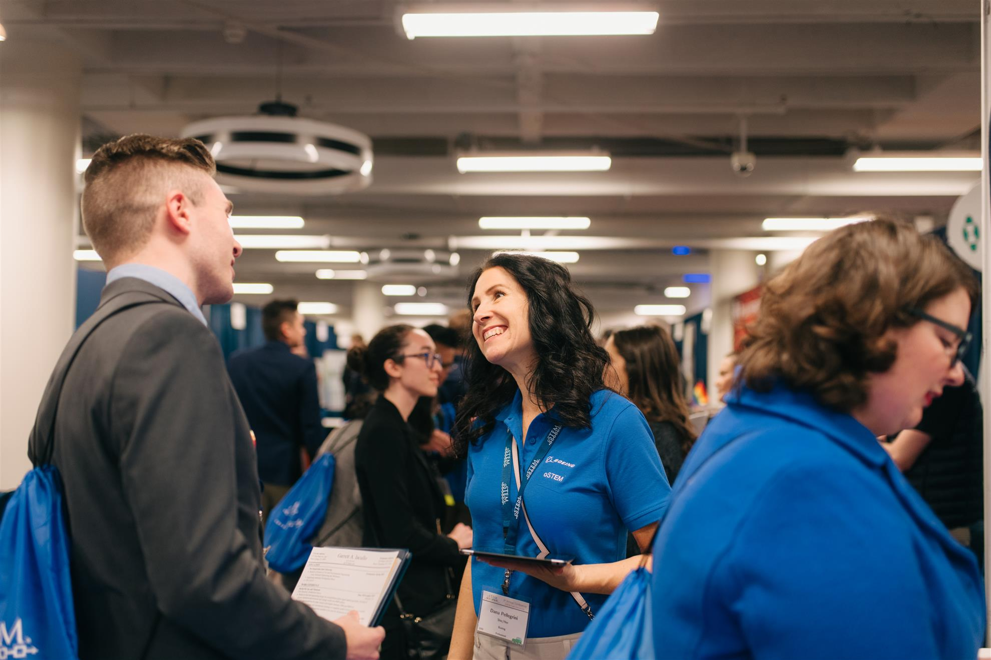 Conference 2019 - People smiling and talking