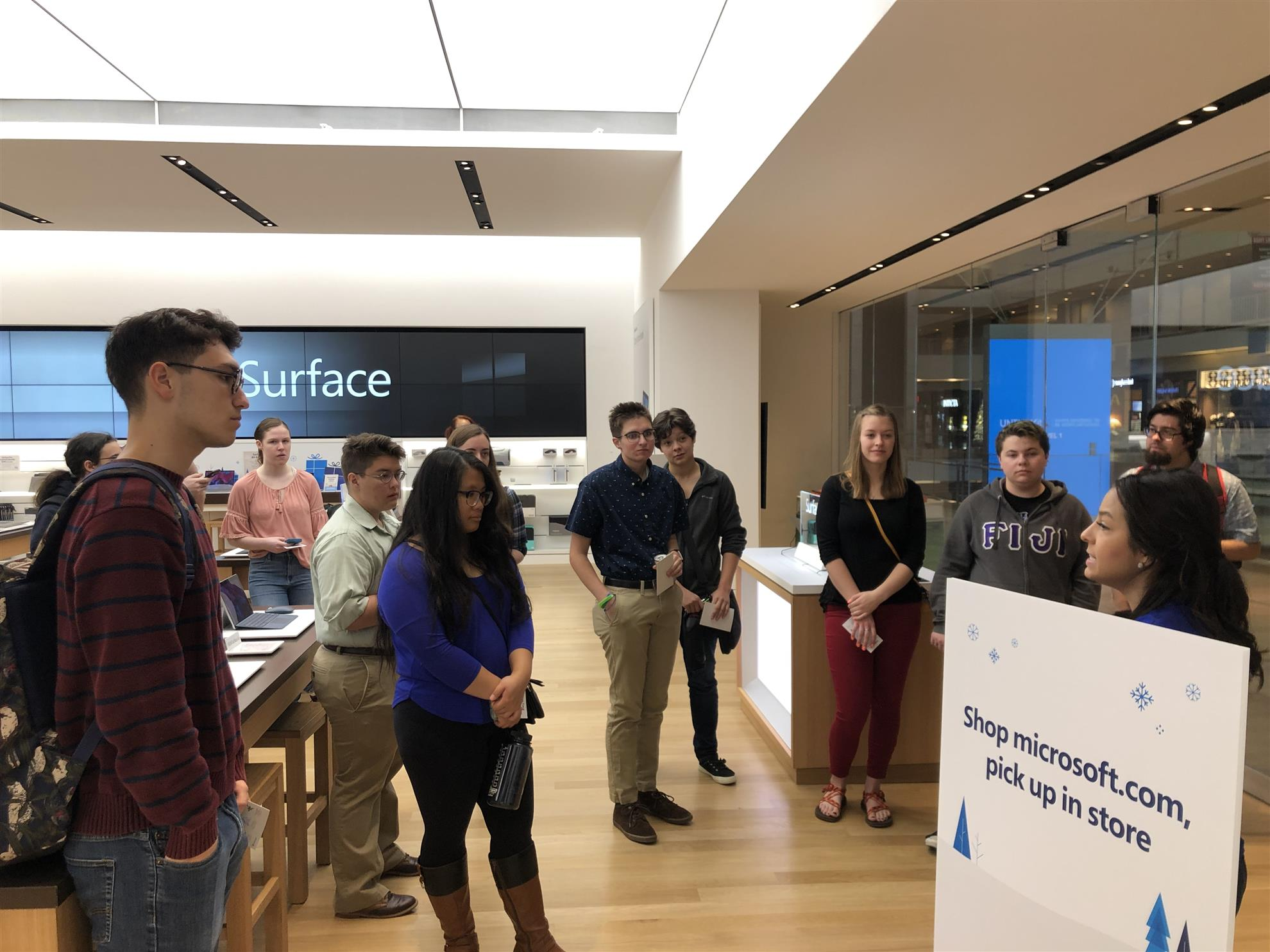Participants enjoy a tour of the Microsoft Store in the Westin Galleria Mall.
