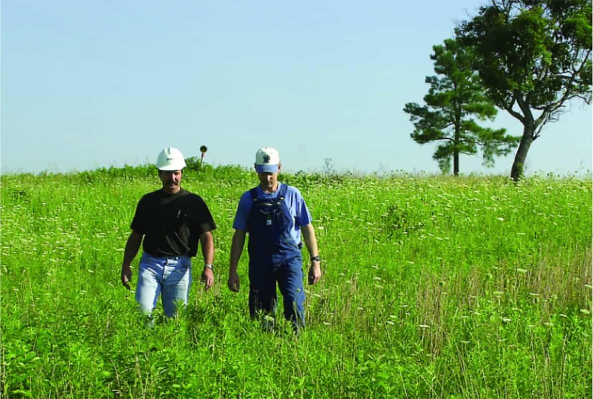 Pipeline representative walking with landowner