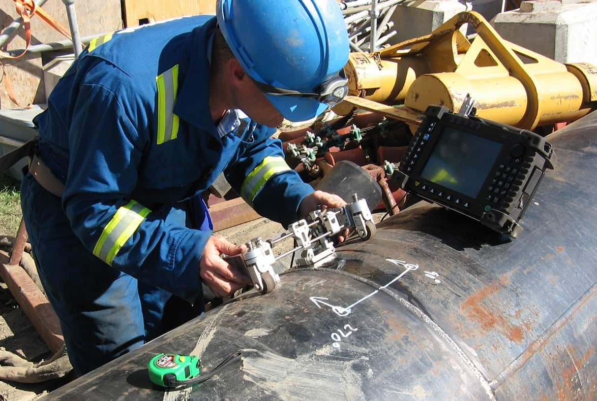 Pipeline operator inspecting pipeline.