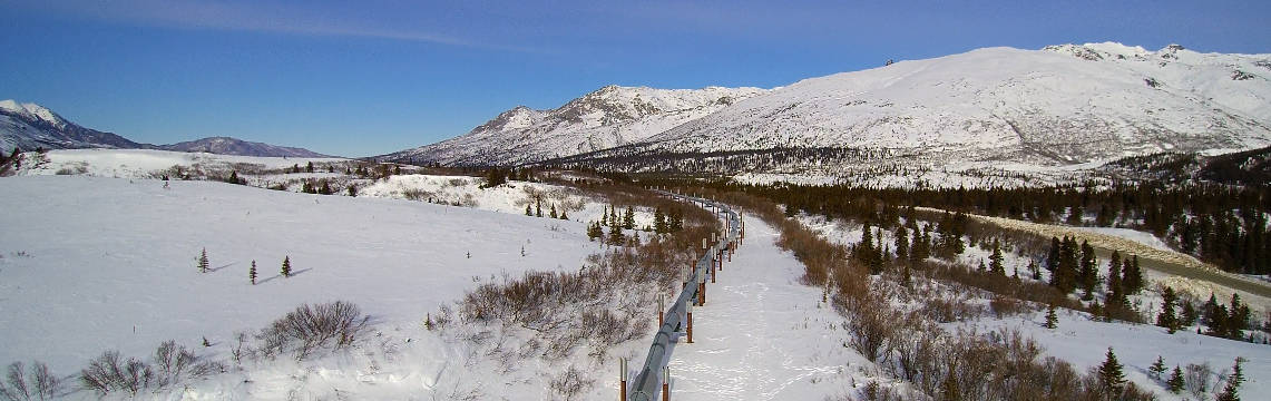 Pipeline stretching through the snowy mountains
