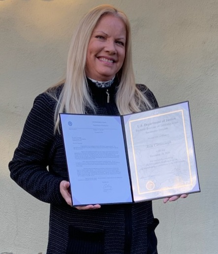 Jean Cavanaugh holding certificate of completion of the FBI Citizens Academy program from the U.S. Department of Justice, FBI Sacramento Division.